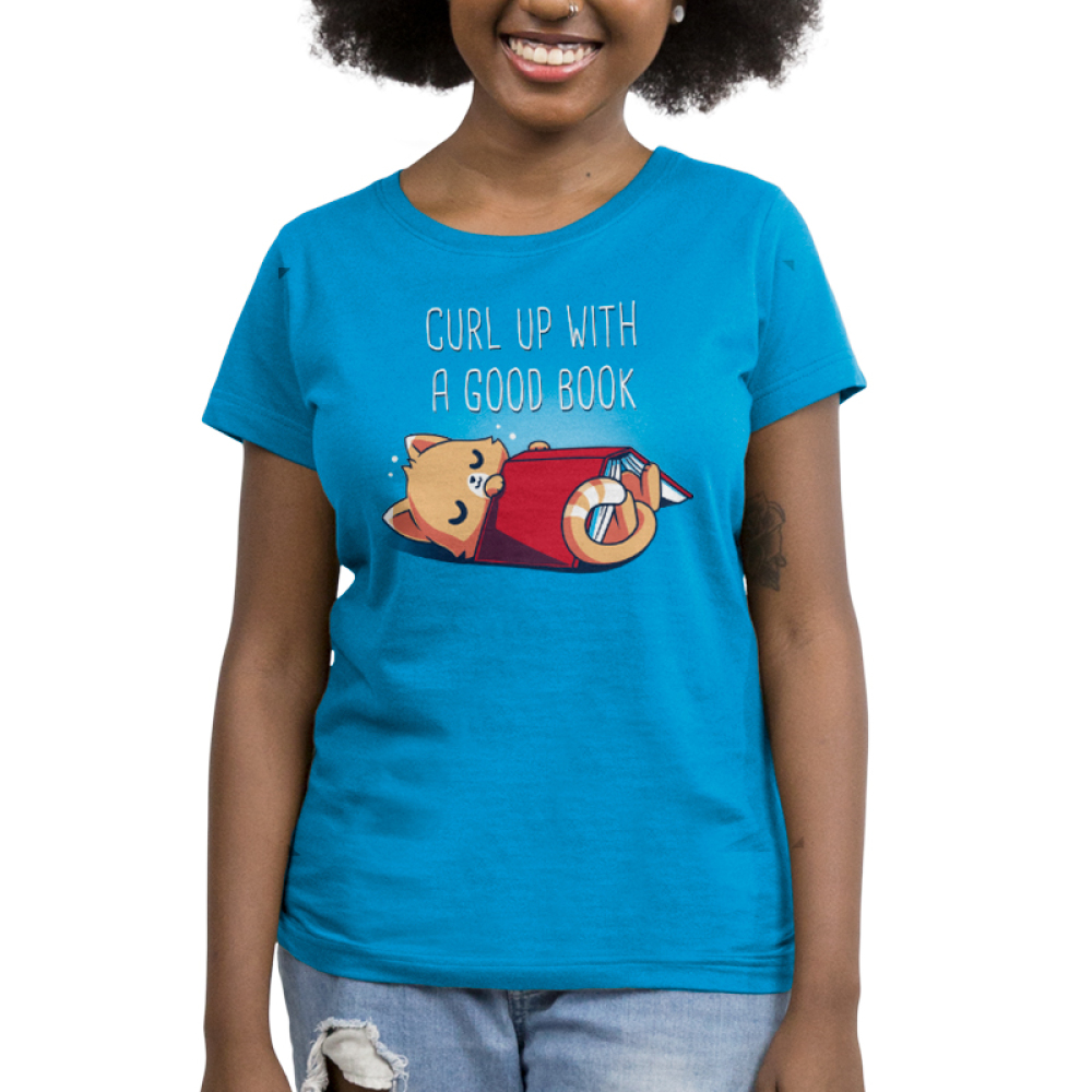 Curl Up With a Good Book Women's t-shirt model TeeTurtle cobalt blue t-shirt featuring a cat snuggling with a book