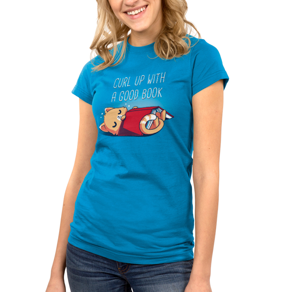 Curl Up With a Good Book Junior's t-shirt model TeeTurtle cobalt blue t-shirt featuring a cat snuggling with a book