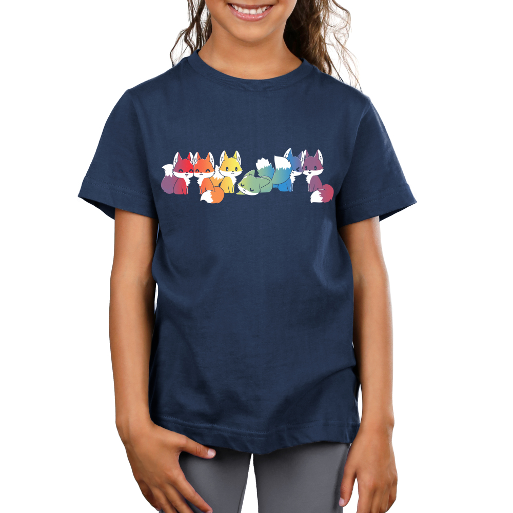 Rainbow Foxes Kid's t-shirt model TeeTurtle navy t-shirt featuring six foxes that are each a different shade of the rainbow