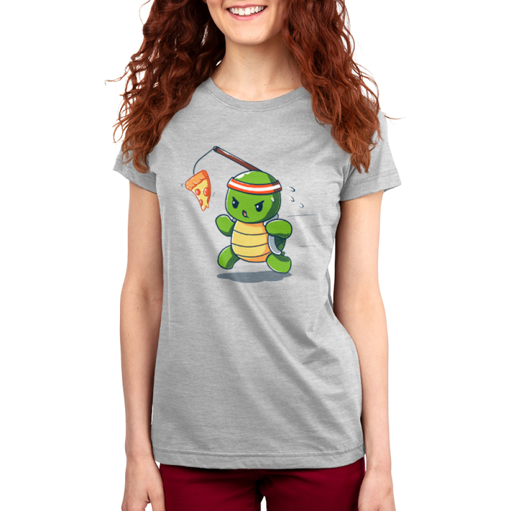Ninja Training Women's t-shirt model TeeTurtle silver t-shirt featuring a turtle with a red sweat band on his head running with a piece of pizza dangling in front of him