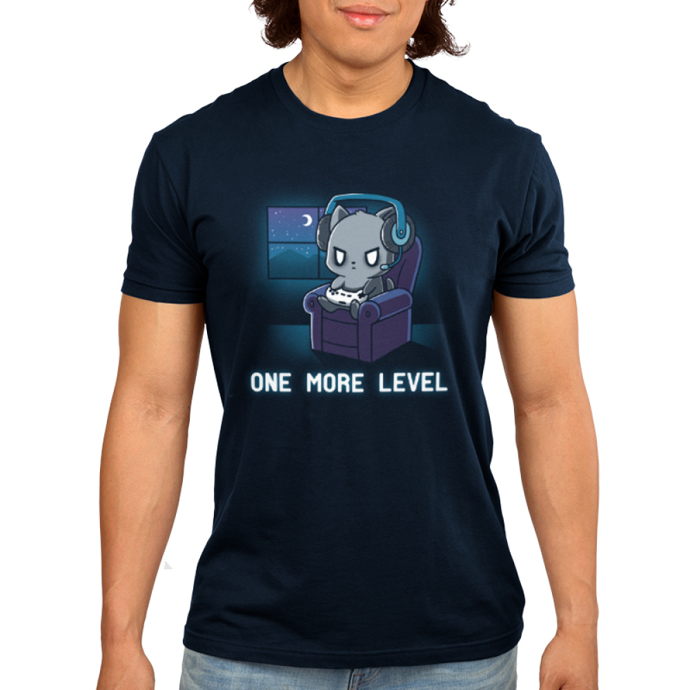One More Level Men's t-shirt model TeeTurtle navy t-shirt featuring a cat sitting on a chair playing video games with a headset on while it is dark outside