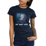 One More Level Junior's t-shirt model TeeTurtle navy t-shirt featuring a cat sitting on a chair playing video games with a headset on while it is dark outside
