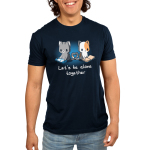Let's Be Alone Together Men's t-shirt model TeeTurtle navy t-shirt featuring two cats creating a heart with their tails, one sitting and reading, and the other sitting and playing video games