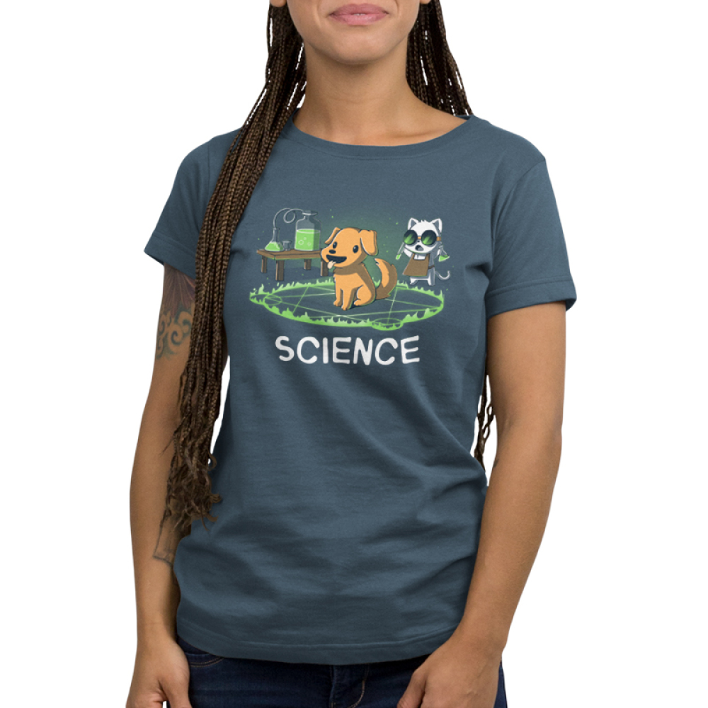 Alchemy = Science Women's t-shirt model TeeTurtle indigo t-shirt featuring a smiling dog in the middle of a green flaming hexagram with a cat wearing goggles standing behind him with two test tubes in his hand