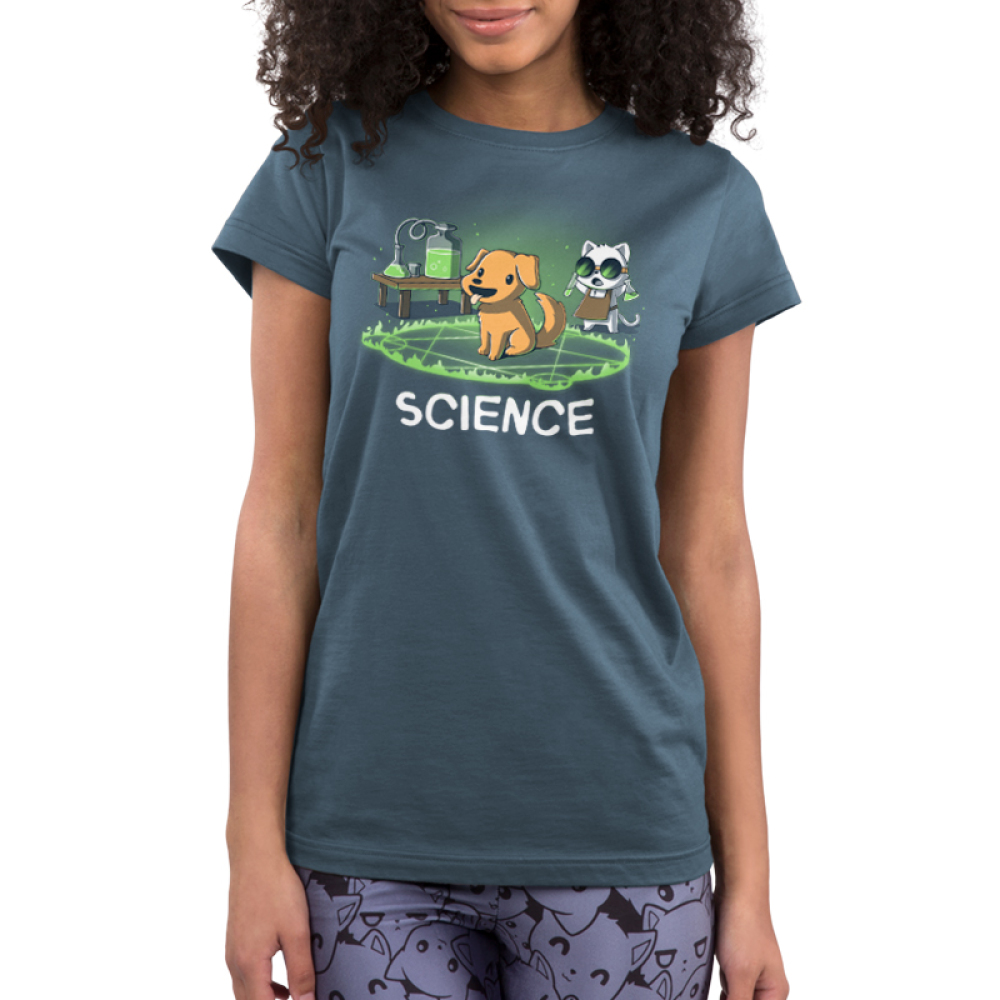 Alchemy = Science Junior's t-shirt model TeeTurtle indigo t-shirt featuring a smiling dog in the middle of a green flaming hexagram with a cat wearing goggles standing behind him with two test tubes in his hand