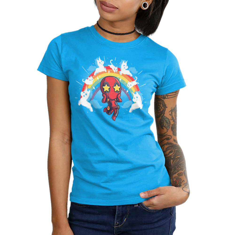 OMG Deadpool! Junior's t-shirt model TeeTurtle officially licensed cobalt blue marvel t-shirt featuring deadpool with stars in his eyes surrounded by a rainbow with white cats and unicorns on it