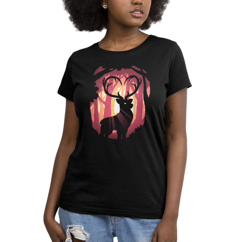 Follow Your Heart (Deer) Women's t-shirt model TeeTurtle black t-shirt featuring a deer in the woods with his antlers forming the shape of a heart