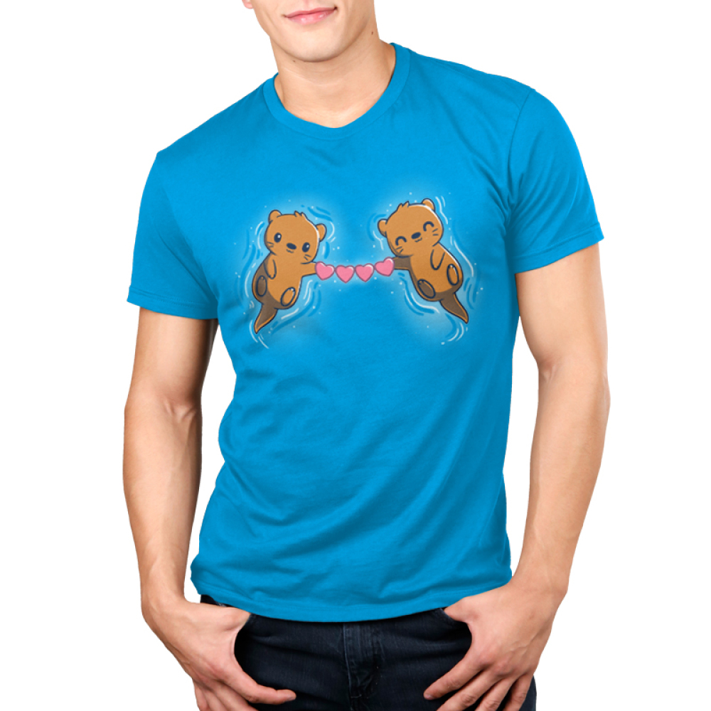 Love Like No Otter Men's t-shirt model TeeTurtle cobalt blue t-shirt featuring two otters smiling on their backs in blue water holding a chain of hearts between them