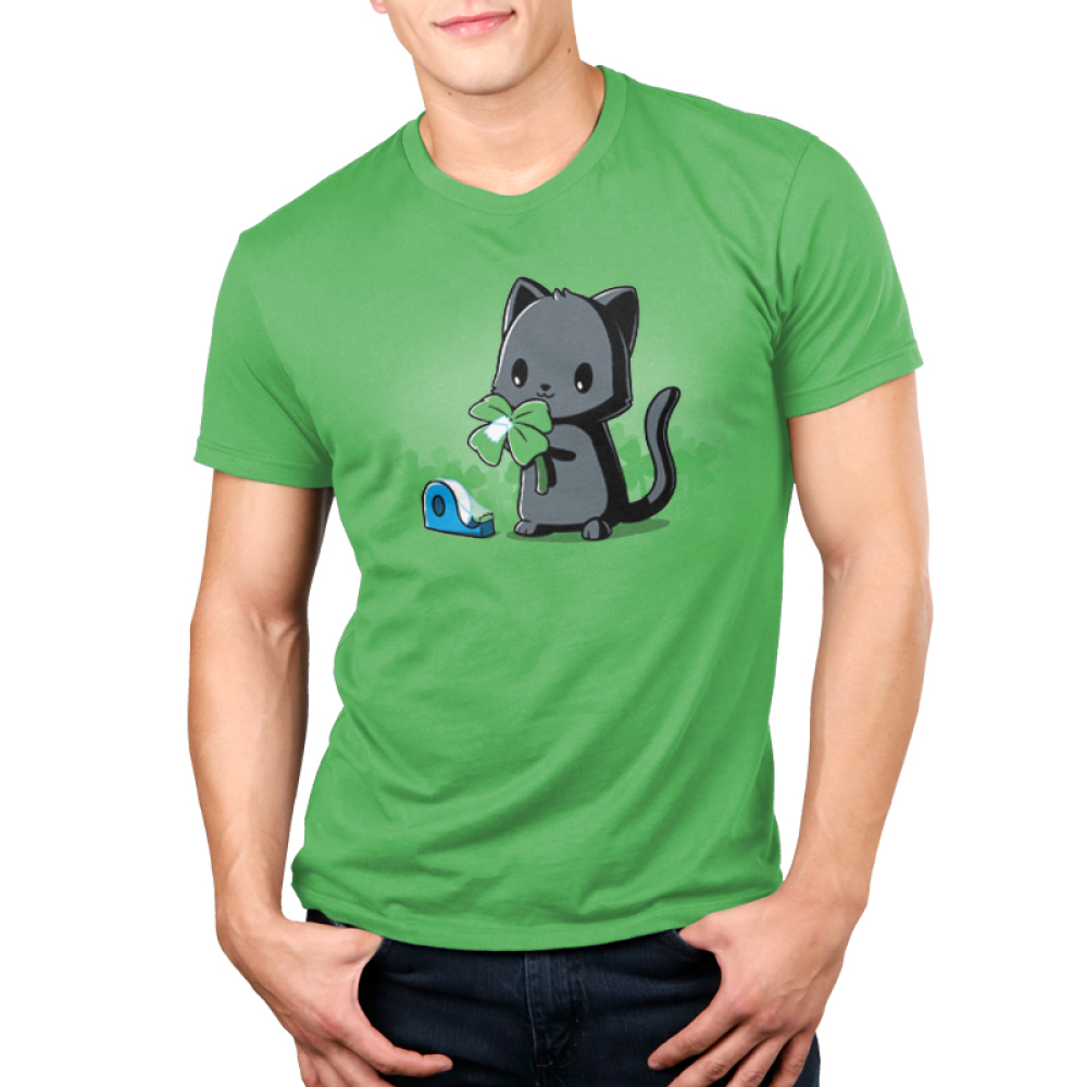 Making Luck Men's t-shirt model TeeTurtle apple green t-shirt featuring a black cat taping an extra leaf to a three leaf clover to make it a four leaf clover
