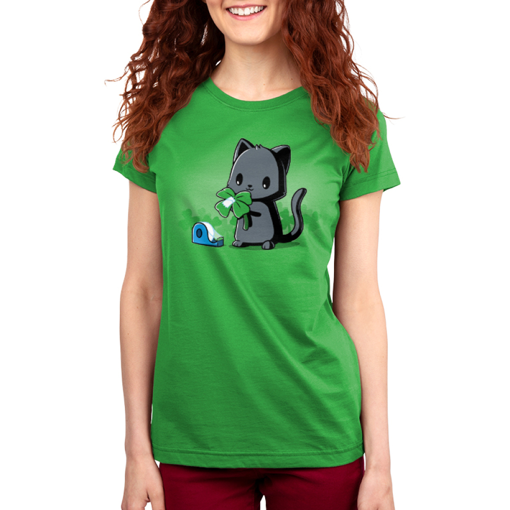 Making Luck Women's t-shirt model TeeTurtle apple green t-shirt featuring a black cat taping an extra leaf to a three leaf clover to make it a four leaf clover