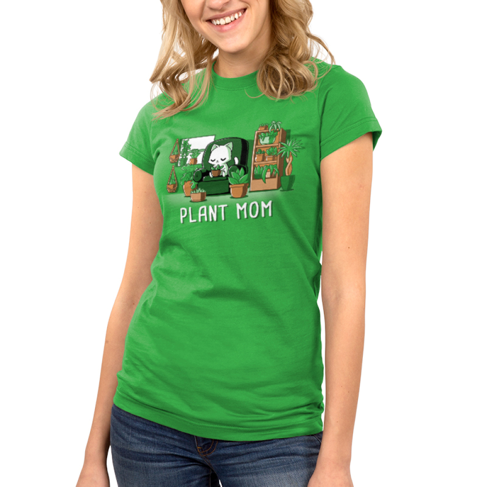 Plant Mom Junior's t-shirt model TeeTurtle apple green t-shirt featuring a white cat sitting on a green chair surrounded by tons of plants