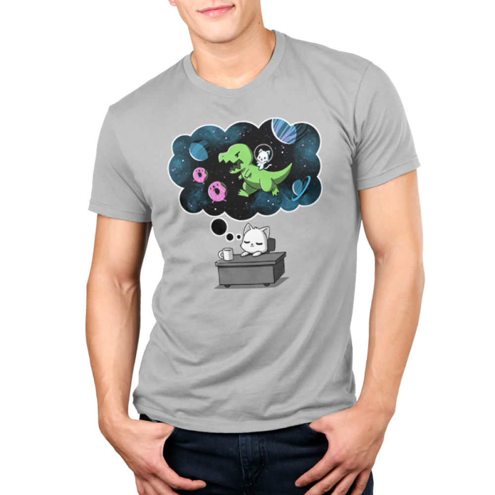 Sweet Escape Men's t-shirt model TeeTurtle silver t-shirt featuring a white cat napping on a desk with a dream bubble above him showing him riding a dinosaur chasing donuts and planets in space