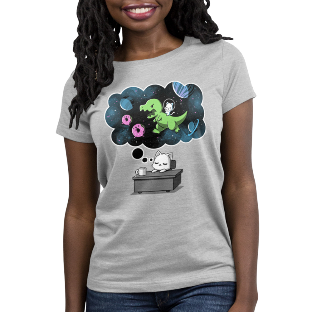 Sweet Escape Women's t-shirt model TeeTurtle silver t-shirt featuring a white cat napping on a desk with a dream bubble above him showing him riding a dinosaur chasing donuts and planets in space