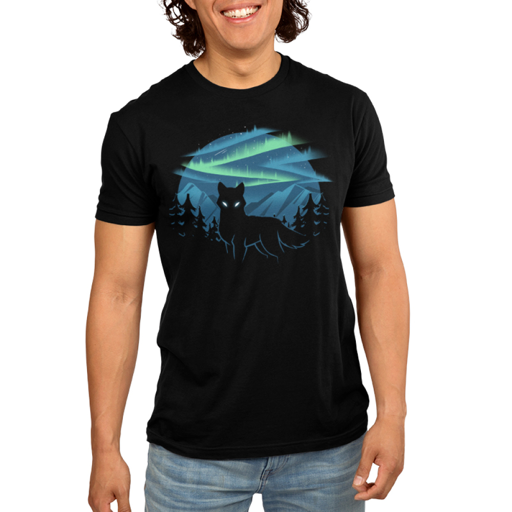 Wild Aurora Men's t-shirt model TeeTurtle black t-shirt featuring a wolf in a forest in the mountains with the northern lights shinning behind him