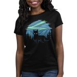Wild Aurora Women's t-shirt model TeeTurtle black t-shirt featuring a wolf in a forest in the mountains with the northern lights shinning behind him