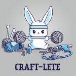 Craft-lete t-shirt TeeTurtle silver t-shirt featuring a bunny in a gray sweatband lifting two balls of yarn on either end of a fitness bar with yarn, a glue gun, scissors, and paint sitting around him