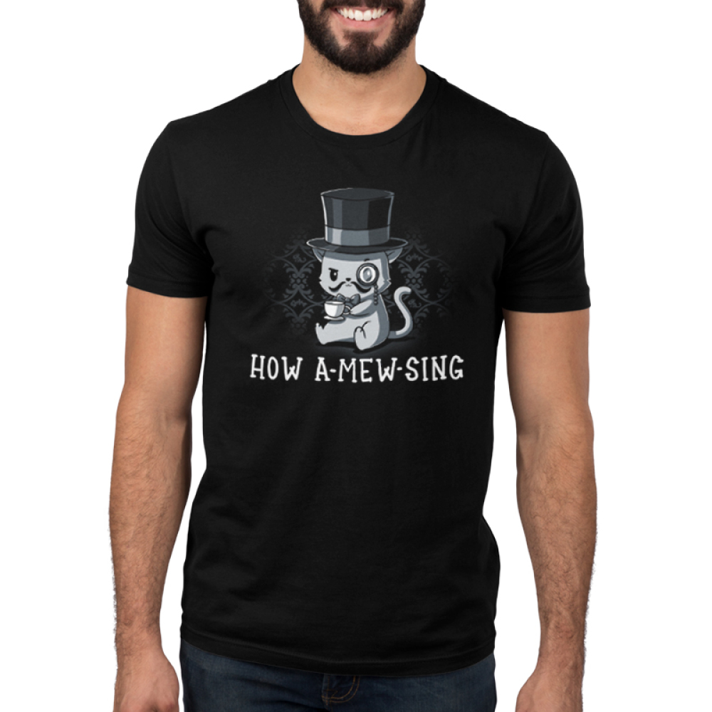 How A-mew-sing Men's t-shirt model TeeTurtle black t-shirt featuring a cat with a top hat, mustache, and monocle with a cup of tea