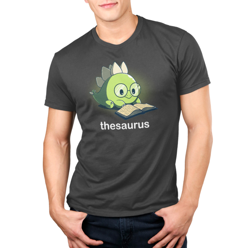 Thesaurus Men's t-shirt model TeeTurtle dark gray t-shirt featuring a green dinosaur with big glasses reading a book