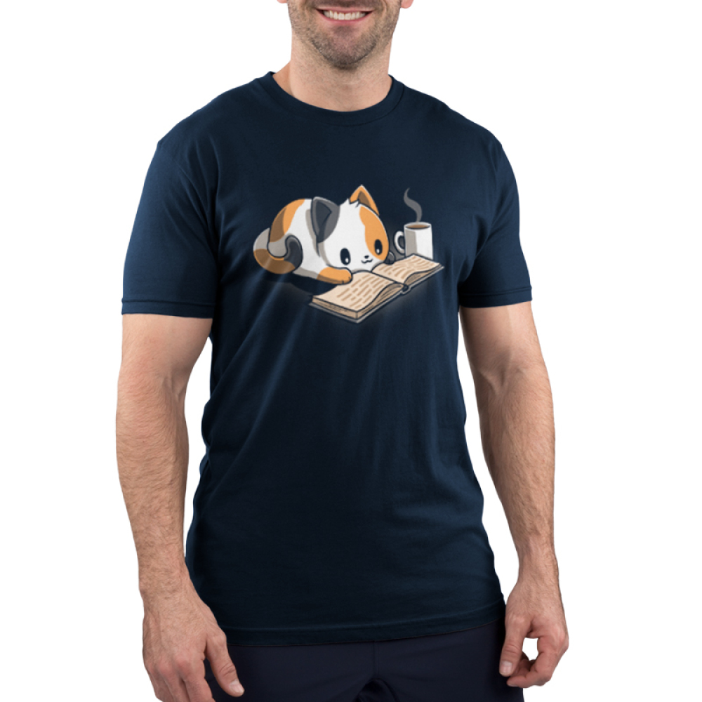 Coffee and a Good Book Men's t-shirt model featuring a calico cat laying down reading a book with a steaming cup of coffee next to him