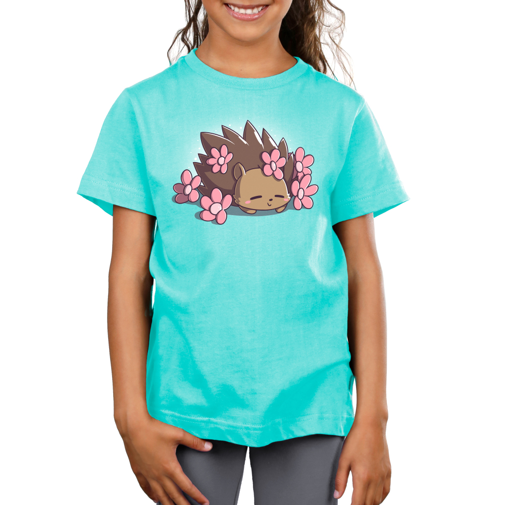 Prickly Petals Kid's t-shirt model TeeTurtle caribbean blue t-shirt featuring a smiling hedgehog covered in prink flowers
