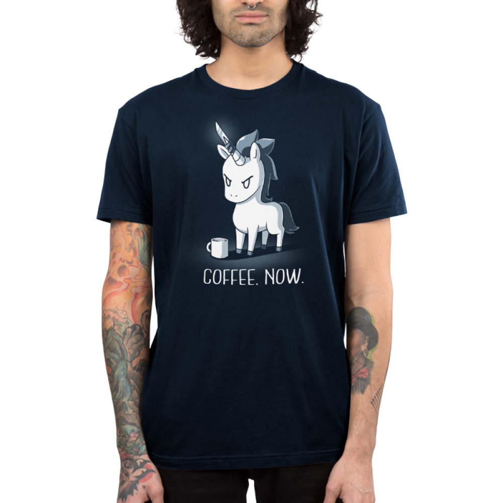 Coffee. Now. Men's t-shirt model TeeTurtle navy t-shirt featuring an angry looking unicorn with a knife on its horn and a coffee mug in front of him