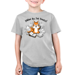 Draw All the Things Kid's t-shirt model TeeTurtle light gray t-shirt featuring an excited looking fox with a pen in one hand and a pencil in the other surrounded by sketchbooks