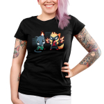Cat Fight Women's t-shirt TeeTurtle black t-shirt featuring two dark buildings behind a crying black cat in a green leotard and gray collar with his left ear on fire that's sitting beside an orange cat wearing a black mask and black leotard that has a red X on it that's standing and waving his gloved paws in the air which is emitting fiery sparks.