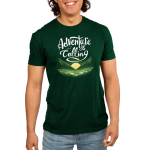 Adventure is Calling Men's t-shirt model TeeTurtle forest green t-shirt featuring a sun rising in between green fields in front of a field of flowers