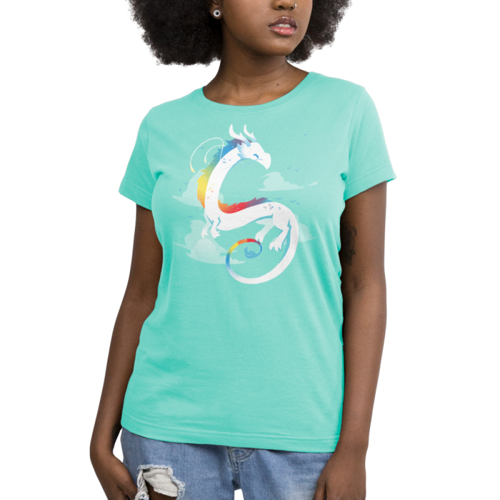 Rainbow Dragon Women's t-shirt model TeeTurtle chill blue t-shirt featuring a white dragon with rainbow coloring flying with clouds in the background