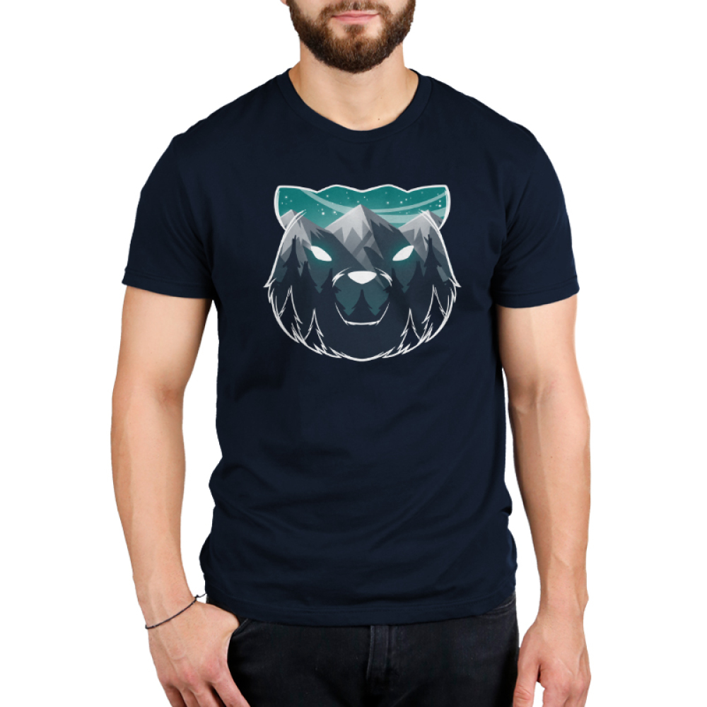 Majestic Mountains Men's t-shirt model TeeTurtle navy t-shirt featuring the outline of a bear face with gray mountains, dark tall trees, and a star filled sky within it