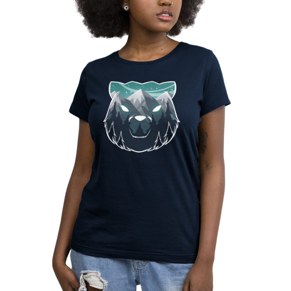 Majestic Mountains Women's t-shirt model TeeTurtle navy t-shirt featuring the outline of a bear face with gray mountains, dark tall trees, and a star filled sky within it