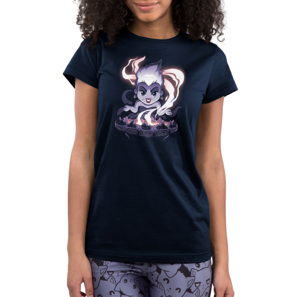 Ursula's Cauldron Junior's t-shirt model officially licensed navy Disney t-shirt featuring Ursula from the little mermaid in front of her smoking cauldron