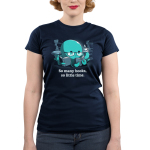 So Many Books, So Little Time (Octopus) Junior's t-shirt model TeeTurtle navy t-shirt featuring a blue octopus in reading glasses with three books in his tentacles and a cup of coffee in another surrounded by stacks of books