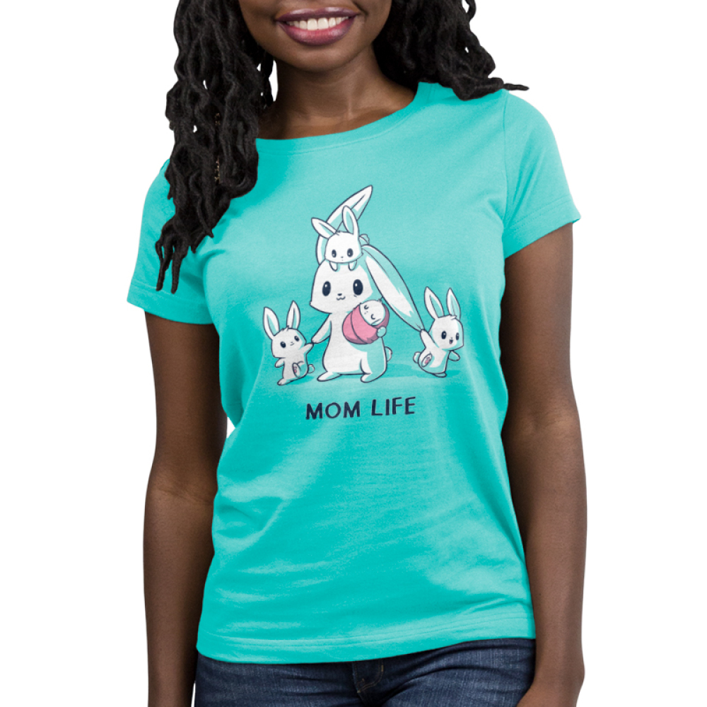 Mom Life Women's t-shirt model TeeTurtle Caribbean blue t-shirt featuring a mama bunny holding a baby bunny with another little bunny on her head and two pulling on her on either side of her