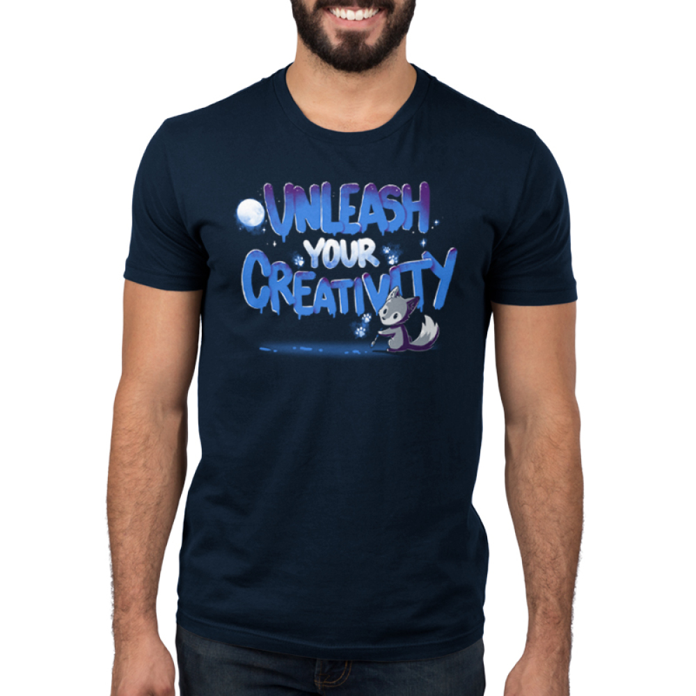 Unleash Your Creativity Men's t-shirt model navy TeeTurtle t-shirt featuring a wolf with a paint brush with a moon and glowing white paws in the background
