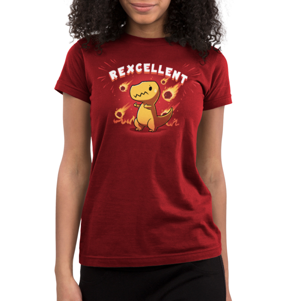 Rexcellent Junior's t-shirt model TeeTurtle garnet red t-shirt featuring a concerned looking dinosaur with this thumbs up while flaming meteors fall behind him