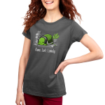 Alone Isn't Lonely Women's t-shirt model TeeTurtle charcoal t-shirt featuring a smiling turtle with head phones on surrounded by books, video games, and a plant