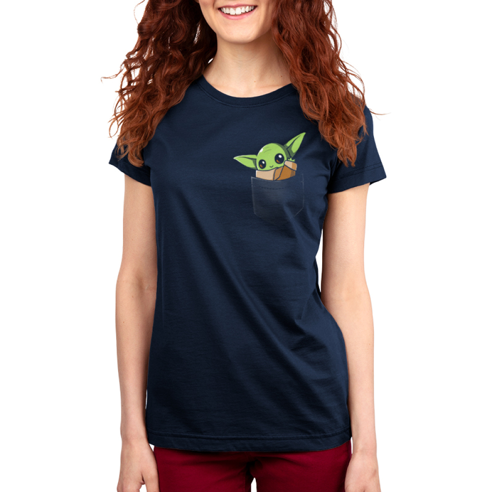 The Child in Your Pocket Women's t-shirt model officially licensed navy Star Wars t-shirt featuring The Child from The Mandalorian sitting in a pocket waving