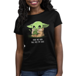 Feed Me and Tell Me I'm Cute Women's t-shirt model officially licensed black Star Wars t-shirt featuring The Child from The Mandalorian holding a little frog