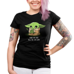 Feed Me and Tell Me I'm Cute Junior's t-shirt model officially licensed black Star Wars t-shirt featuring The Child from The Mandalorian holding a little frog