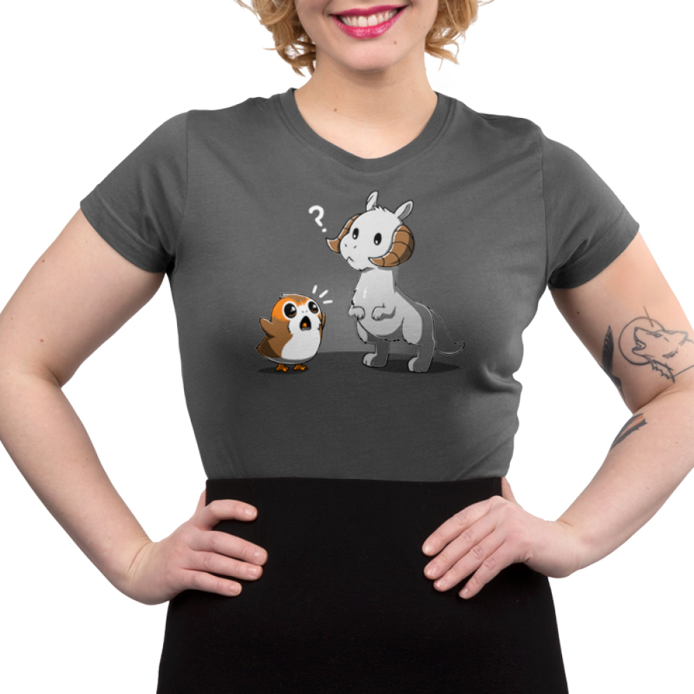 Tauntaun Meets Porg Junior's t-shirt model officially licensed charcoal Star Wars t-shirt featuring porg yelling with his arms up in front of Tauntaun who looks confused