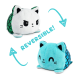 An angry reversible mercat plushie with a white face and blue sparkling tail flipping to a happy reversible mercat plushie with an aqua face and green sparkling tail.