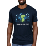 Reach for the Stars Men's t-shirt model TeeTurtle navy t-shirt featuring a green t-rex reaching for meteors falling in the sky with two dinosaurs behind him