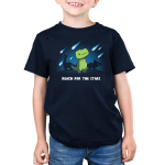 Reach for the Stars Kid's t-shirt model TeeTurtle navy t-shirt featuring a green t-rex reaching for meteors falling in the sky with two dinosaurs behind him