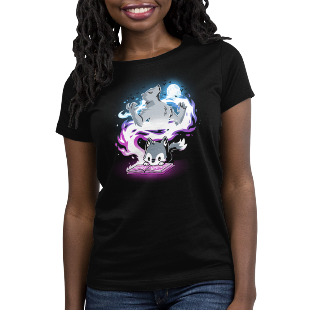 Moonlight Tale Women's t-shirt model TeeTurtle black t-shirt featuring a fox reading a book with a big spiral of light behind him with a big wolf and a full moon