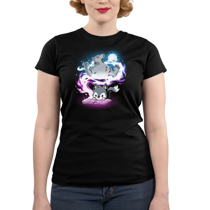 Moonlight Tale Junior's t-shirt model TeeTurtle black t-shirt featuring a fox reading a book with a big spiral of light behind him with a big wolf and a full moon