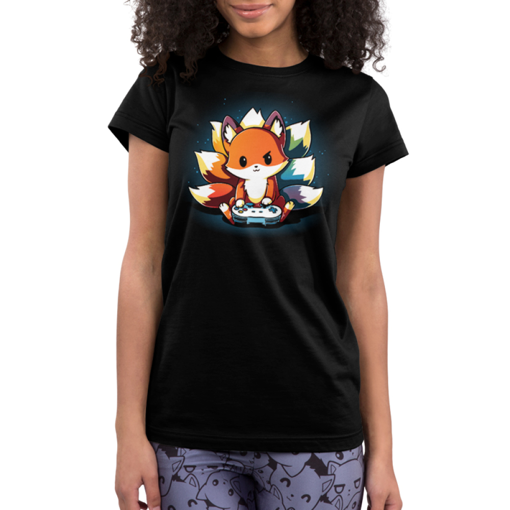 Rainbow Gamer Junior's t-shirt model TeeTurtle black t-shirt featuring a kitsune with different colored tails holding a video game controller