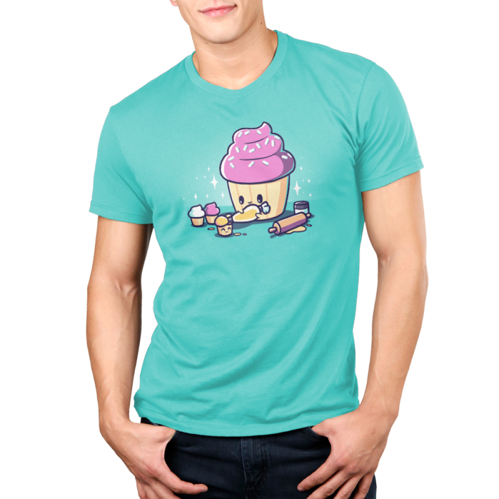 Baking Cupcakes Men's t-shirt model TeeTurtle Caribbean blue t-shirt featuring a big pink cupcakes icing a little smiling cupcakes with a rolling pin and other little cupcakes around them