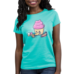 Baking Cupcakes Women's t-shirt model TeeTurtle Caribbean blue t-shirt featuring a big pink cupcakes icing a little smiling cupcakes with a rolling pin and other little cupcakes around them