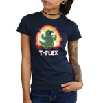 T-Flex Junior's t-shirt model TeeTurtle navy t-shirt featuring an angry looking green dinosaur flexing its muscular arms with an explosion behind him
